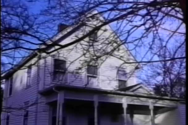 Establishing shot of house with front porch