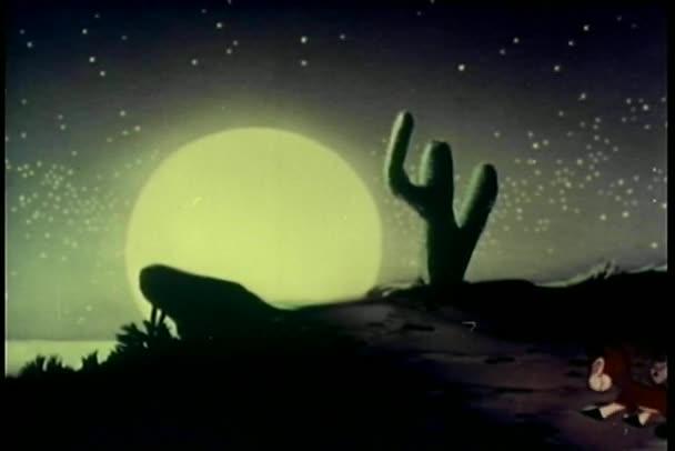 Two donkeys walking down path towards full moon