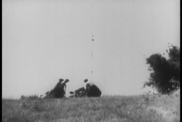 Low angle view of men working in field with pickaxes