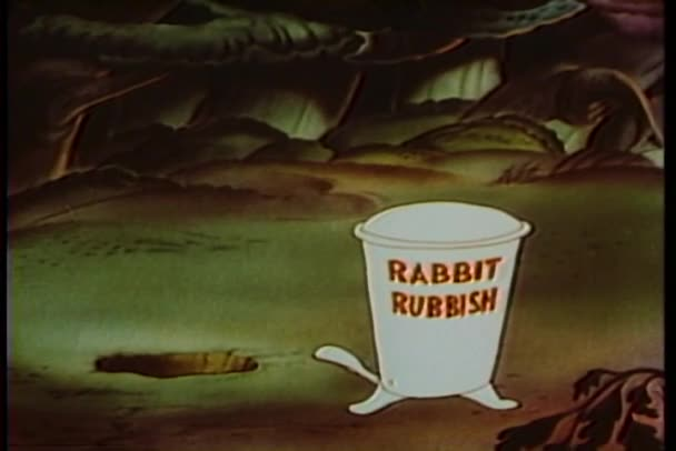 Cartoon of rabbit throwing rubbish out of a hole and into a trash can