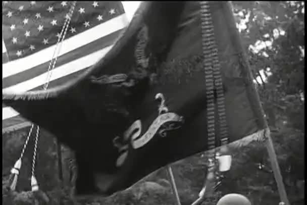 Close-up military flag blowing along side American flag