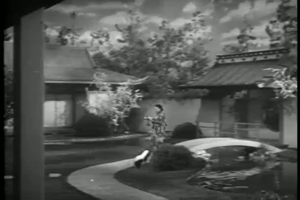 Woman in kimono carrying tray