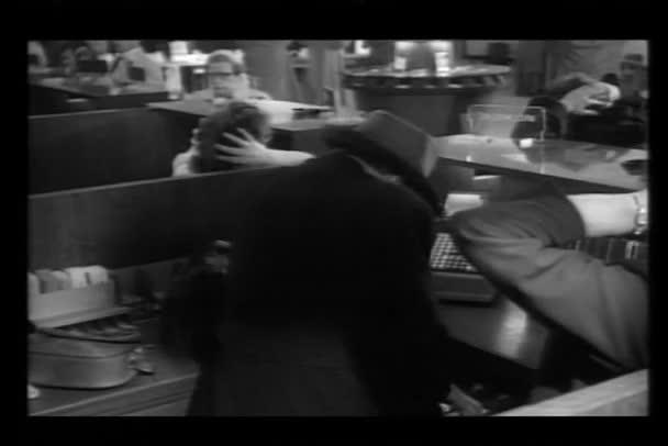 Robber stealing money from bank teller