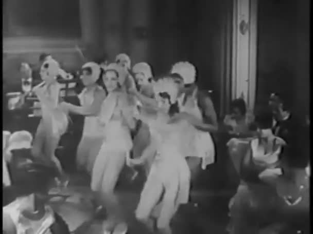 Female tap dancers performing together in nightclub
