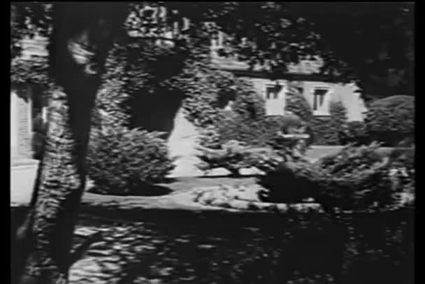 Man entering mansion