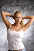Fotografie Blond girl in white shirt