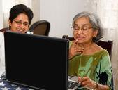Elderly woman laptop