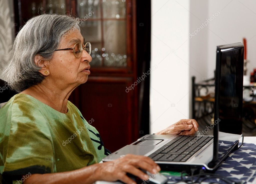 a10fa26b99 Elderly Asian Indian woman uses a laptop computer at home — Photo by ...