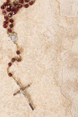 Rosary beads on stone with copy space