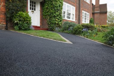 New bitumen driveway outside a beautiful brick house in London. Plenty of space for text. stock vector