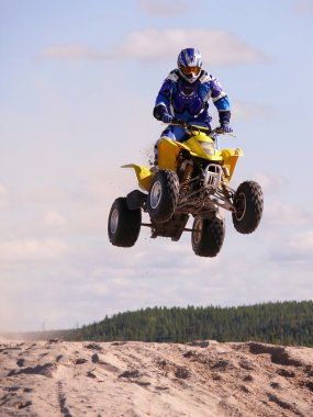 Vadim Vasuhin in jump with springboard on quadrocycle during extreme motorcross racing August 26, 2007 in Nadym, Russia.