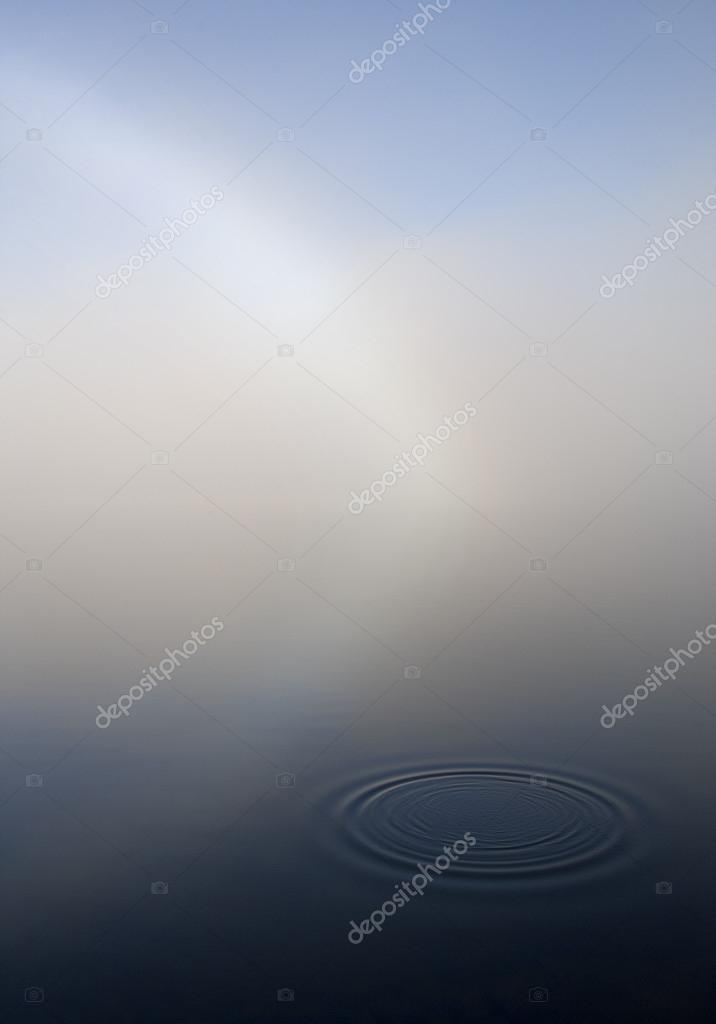 Abstract fresh water ripple on gray background