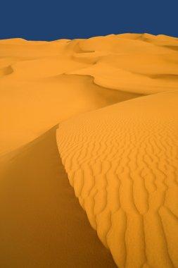 Sand dunes at sunset in the Sahara Desert, Libya.