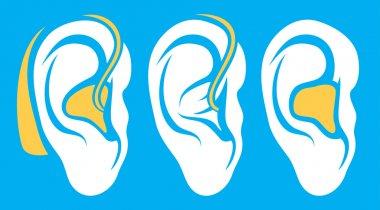 Hearing aid on white ear