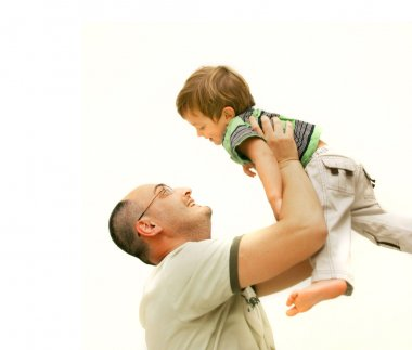 Loving father and son over white