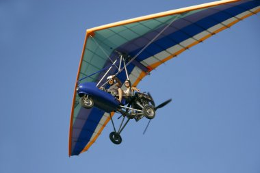 moto hang glider in flight