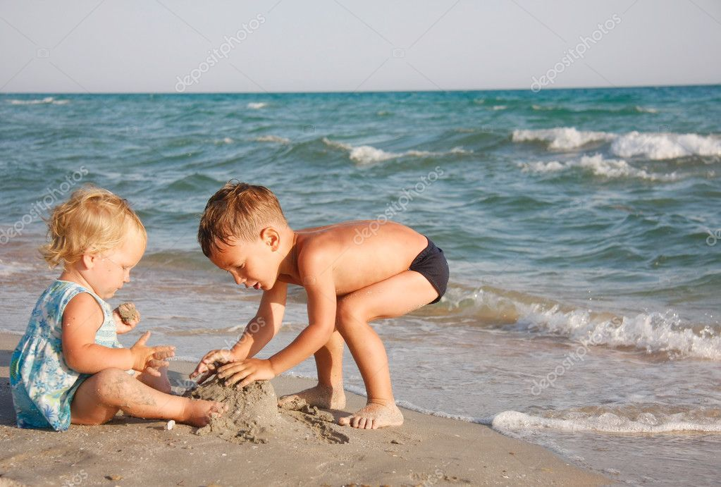 two kids playing on beach