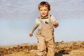 Fotografie Detailní záběr prchajícího chlapce