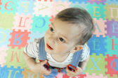 Boy on colorful background with letters