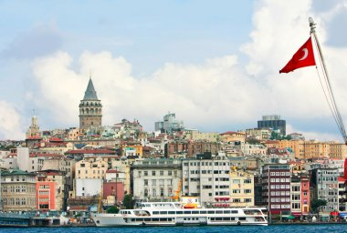 turkish flag on galata tower background, istanbul, turkey