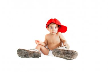 Toddler boy in parent's boots over white stock vector