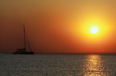 ship silhouette on sunset sea background
