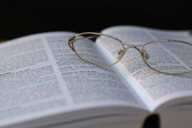 glasses on book page