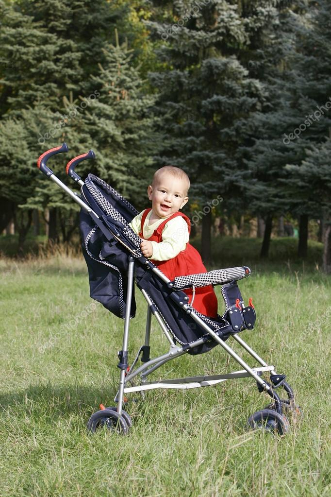 Smiling baby boy in stroller