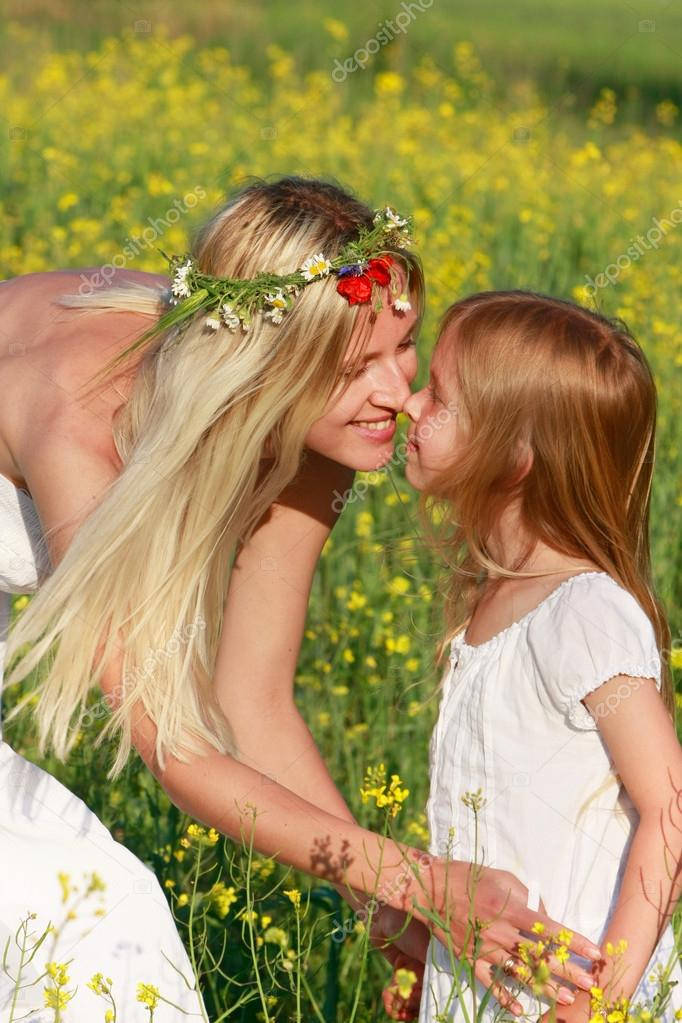 loving mother and daughter on nature