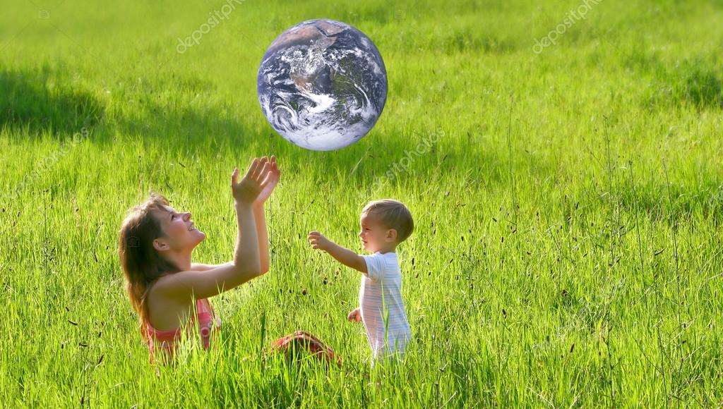 mother and son playing with earth-like ball