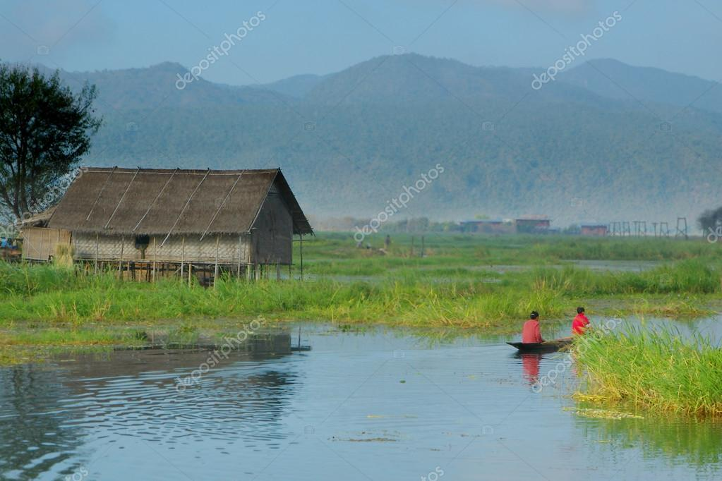Stilt house on lake