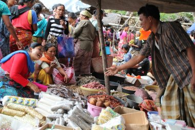Buyers and sellers at a traditional market in Lombok Indonesia