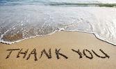 Danke Wort auf den Sand am Strand gezeichnet