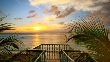 The view from the terraces of the beautiful sunset on the beach.