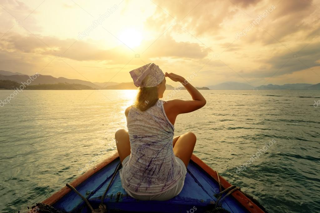 depositphotos_43749583-stock-photo-woman-traveling-by-boat-at.jpg