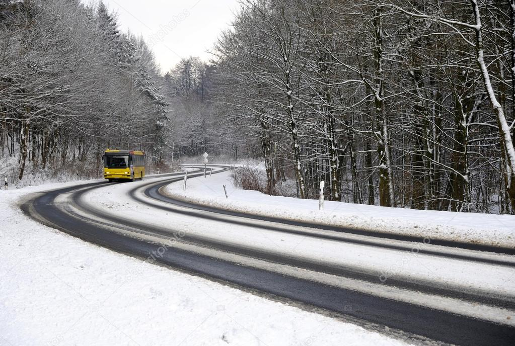 Winter road with bus