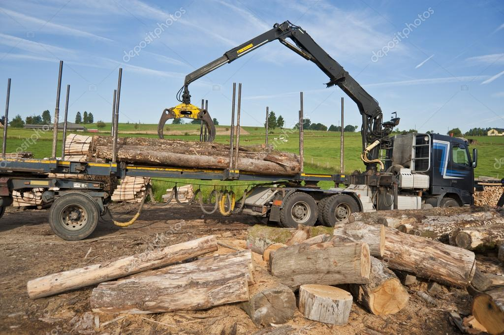 Truck crane loading timber