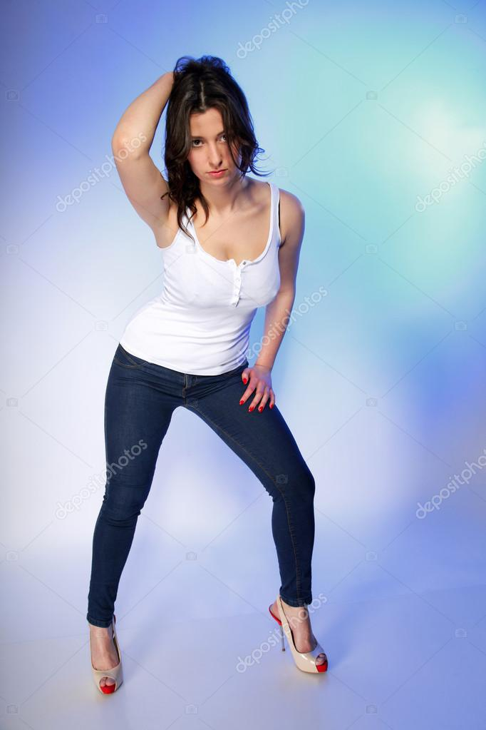 Sexy girl in white t-shirt and jeans studio — Stock Photo ...