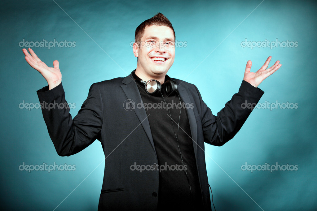 Young Happy Man With Headphones On Blue Stock Photo