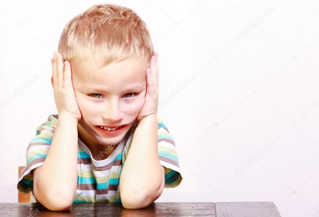 aead1bd1d Portrait of sad emotional blond boy child kid at the table — Stock ...