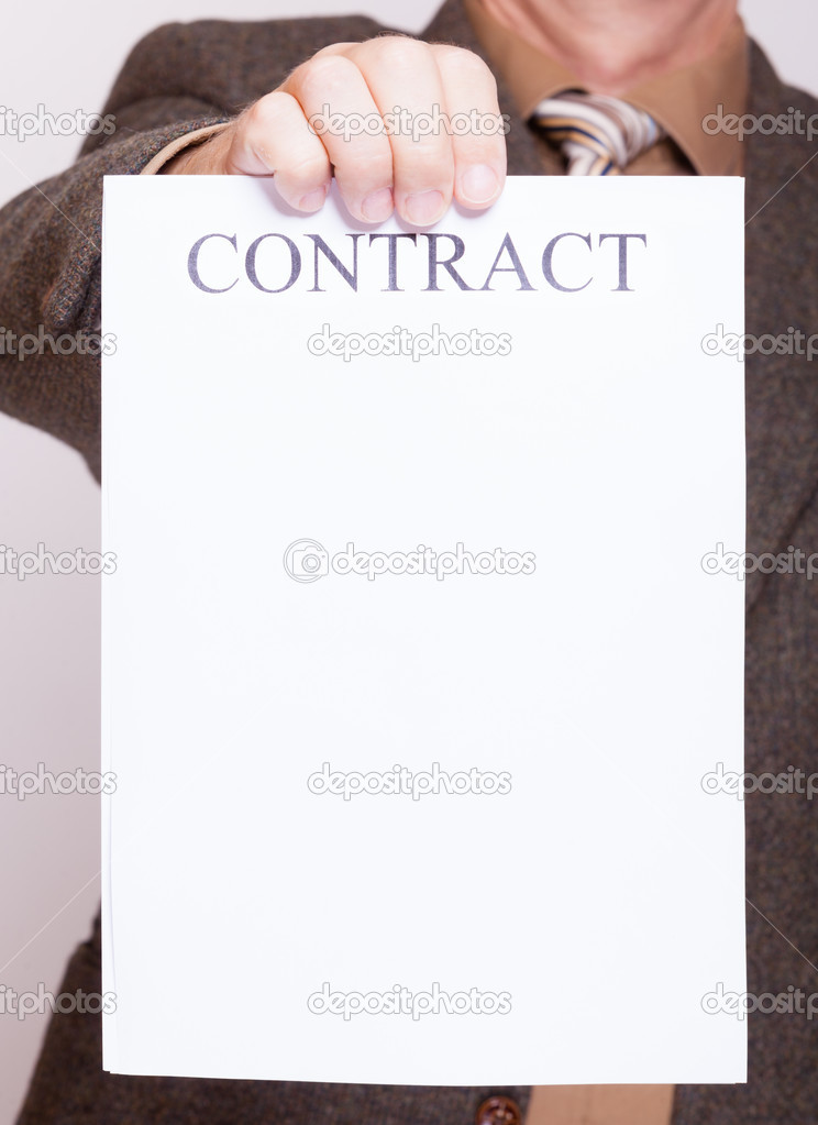 Businessman holding blank paper with sign contract — Stock Photo ...
