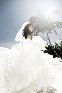 Beautiful young caucasian bride on the beach