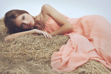 Girl lying on hay