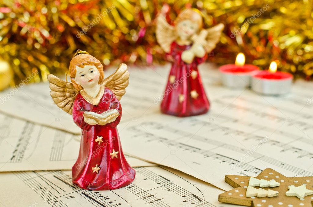 Christmas figurine of angels on a music sheet