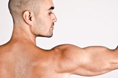 Close up on profile of a man and the arm with the shoulder and biceps.