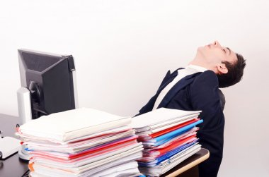 Tired business man sleeping at work.
