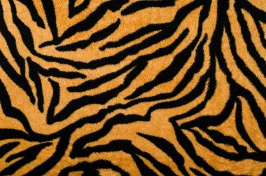 Brown and black tiger pattern. Fur animal print as background.