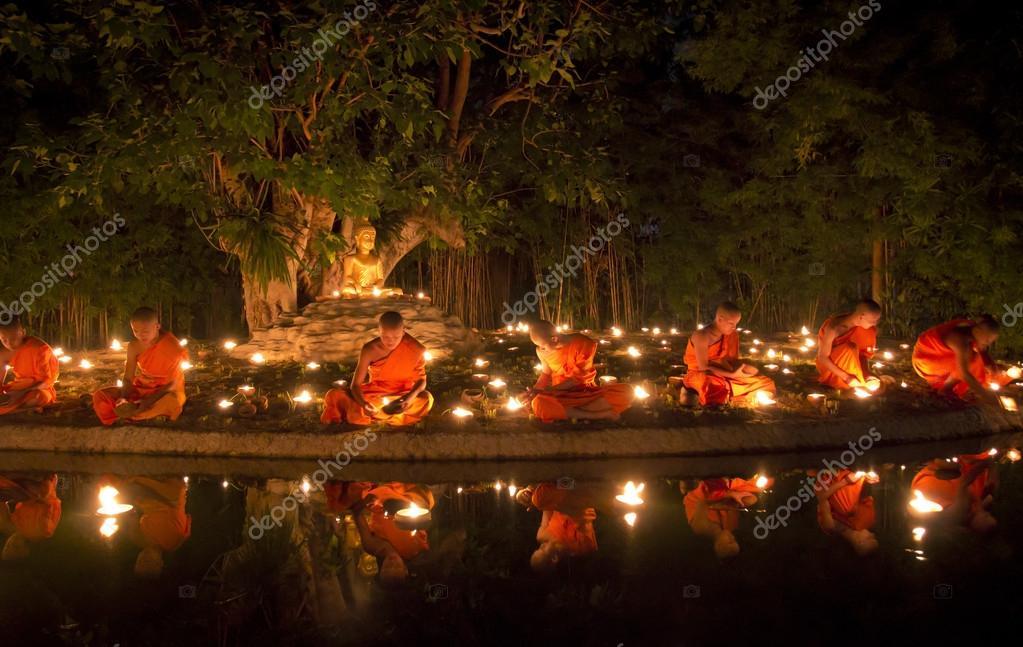 Buddhist monk fire candles