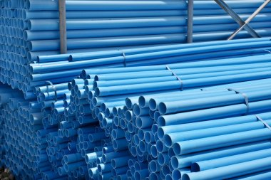 Stack of blue pvc pipes