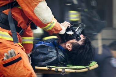 The rescue workers move hurt person with a stretcher